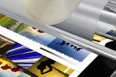 stock photo of laminate  - The laminator equipment for a press in a modern printing house - JPG