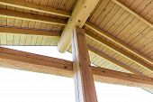 stock photo of structure  - Interior view of a wooden roof structure rafters and trusses
