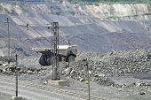 stock photo of iron ore  - Iron ore opencast mining site - JPG