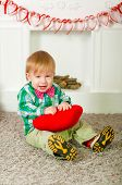 stock photo of naked children  - Child bow tie sitting near the fireplace at home - JPG