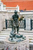 picture of metal sculpture  - Old man and fish sculpture in Moscow Russia - JPG