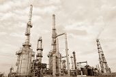 picture of greenpeace  - Oil refinery in sepia in New Mexico state - JPG