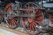 foto of locomotive  - View of wheels of classic steam locomotive - JPG