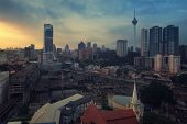 pic of kuala lumpur skyline  - Sunset over Kuala Lumpur skyscrapers, Malaysia. Aerial view of the city center