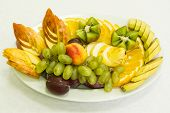 stock photo of fruit platter  - Selection of tropical fruit on glass plate - JPG