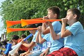 the children blow the vuvuzela