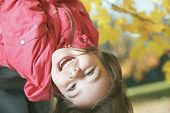 picture of upside  - A upside down girl in autumn background - JPG
