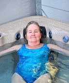 image of hot-tub  - Mature female blond beauty relaxing in her hot tub outdoors - JPG