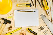 pic of carpentry  - Planning a Project in Carpentry and Woodwork Industry Notebook and Assorted Woodwork and Carpentry Tools on Pinewood Workshop Table - JPG