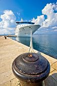 foto of bollard  - Cruiser ship tied on mooring bollard vertical view - JPG