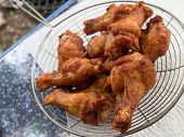 pic of southern fried chicken  - Homemade fried chicken drumsticks cooking with original thai style. ** Note: Shallow depth of field - JPG