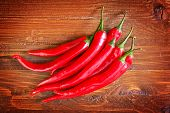 pic of red hot chilli peppers  - red hot chilli peppers on the wooden table - JPG