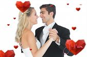 stock photo of waltzing  - Sweet married couple dancing viennese waltz against valentines love hearts - JPG