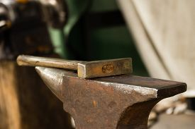 pic of blacksmith shop  - Tools - hammer and anvil used by a blacksmith in old shop ** Note: Soft Focus at 100%, best at smaller sizes - JPG