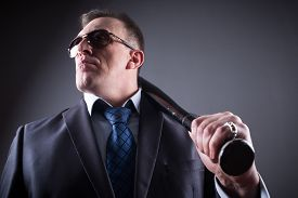 stock photo of bat  - adult male gangster with glasses and a baseball bat - JPG