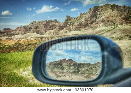 Badlands Mountains In Rear-view Mirror