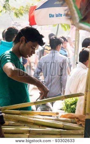 Sugarcane Juice Vendor Pouring Juice