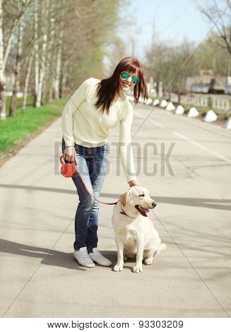 Happy Owner And Labrador Retriever Dog Outdoors Walking In Summer Day