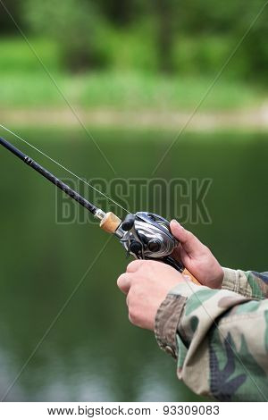 Spinning Reel And In The Hands Of