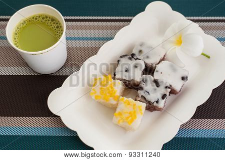 Traditional Thai Dessert With Hot Milk Green Tea  On Plate
