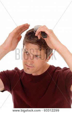 Man Brushing His Hair.