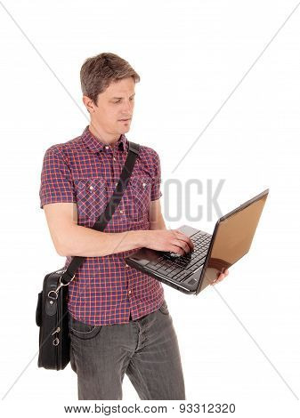 Standing Man With Laptop