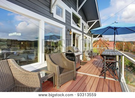 Northwest Traditional Wooden Deck With Chairs.