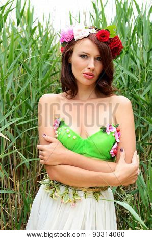 Woman Surrounded By Reeds