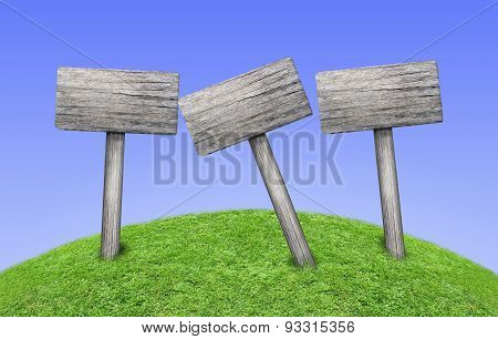 3 Wooden Signposts On Green Meadow