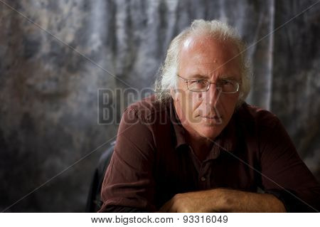 Listening Blue Eyed Man With Glasses And Grey Hair