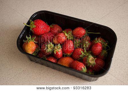 Fresh Strawberries In Black Plastic Box