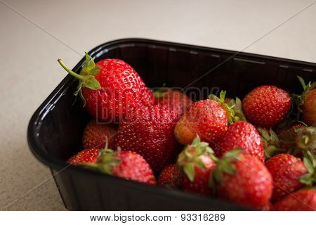 Fresh Strawberries In Black Plastic Box