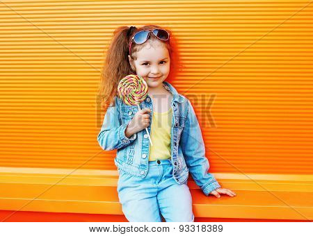 Fashion Kid - Stylish Little Girl Child Wearing A Jeans Clothes And Sunglasses With Sweet Caramel Ha