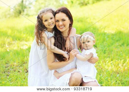 Happy Young Family, Mother And Two Daughters Childrens Together Having Fun Outdoors On The Nature