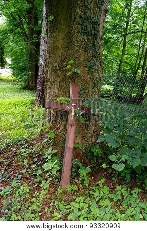 Old Wooden Cross In A Graveyard