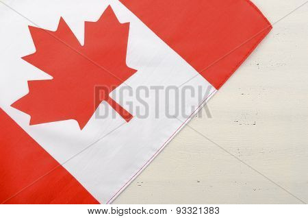 Canadian Red Maple Leaf Flag On White Wood Background.