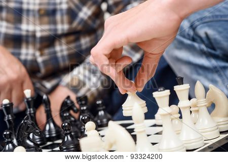 Close-up of men playing chess
