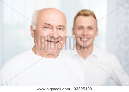 Close-up of grandson and grandfather