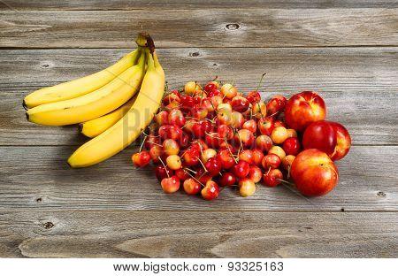 Fresh Fruit Displayed On Rustic Wood