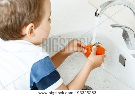 Little child washing vegetable