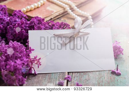 Postcard With  Lilac Flowers And Empty Tag For Text