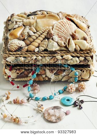 Collection Of Jewelry In Jewelry Box Decorated With Seashells