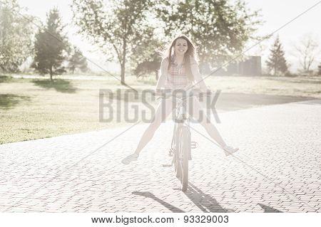 Smiling Girl Riding On Bicycle