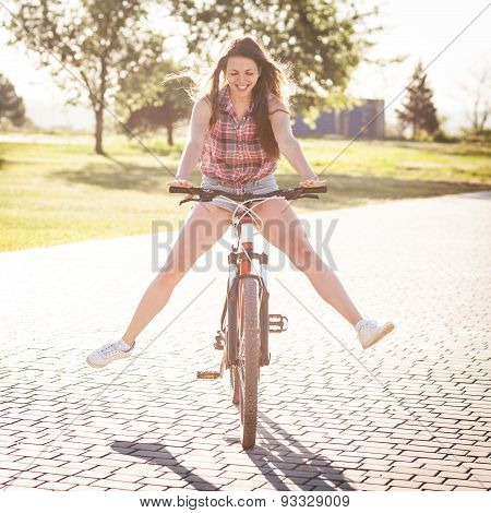 Laughing Girl Riding On Bicycle