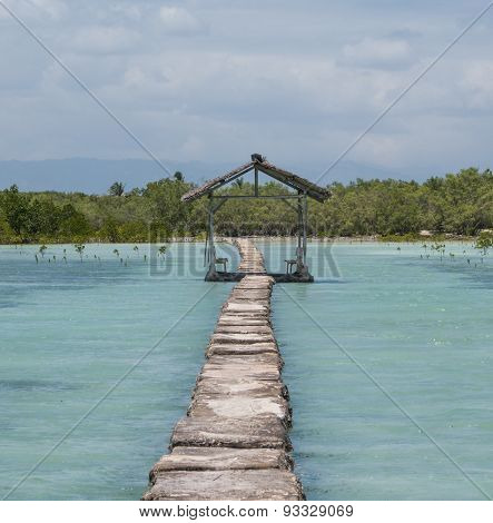 Stone Path And Covered Hut Over Turquiose Waters