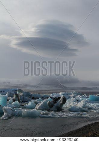 Tranquil Blue Icebergs In Jokulsarlon Lake