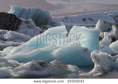 Blue Iceberg Floating In Jokulsarlon Lake, Iceland