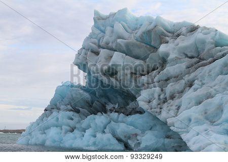 Large Blue Iceberg In Jokulsarlon Lake