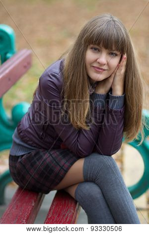 Beautiful Girl On A Bench In The Park