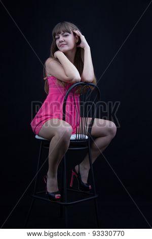 Young Girl On A Bar Stool